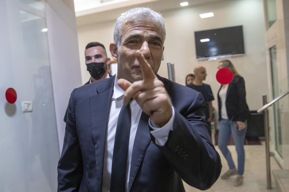 """REPLACES COMMON GOOD INSTEAD OF COMMON GROUND - Israeli opposition leader Yair Lapid, arrives for a news conference in Tel Aviv, Thursday, May. 6, 2021. Lapid called on his potential partners to find """"common good"""" and expressed optimism that a new coalition government would be formed. (AP Photo/Oded Balilty)"""