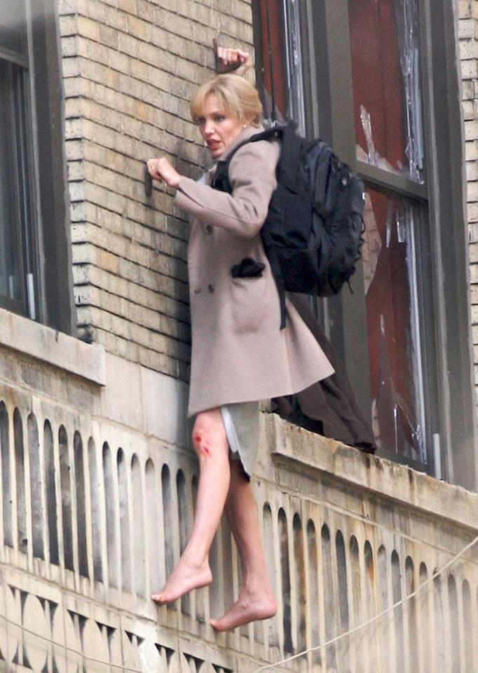 "Angelina Jolie displayed her new blond coif -- and her mettle -- as she hung barefoot from a wall on the set of her new thriller ""Salt"" on Wednesday. PPNY/GSNY/<a href=""http://www.splashnewsonline.com"" target=""new"">Splash News</a> - March 12, 2009"