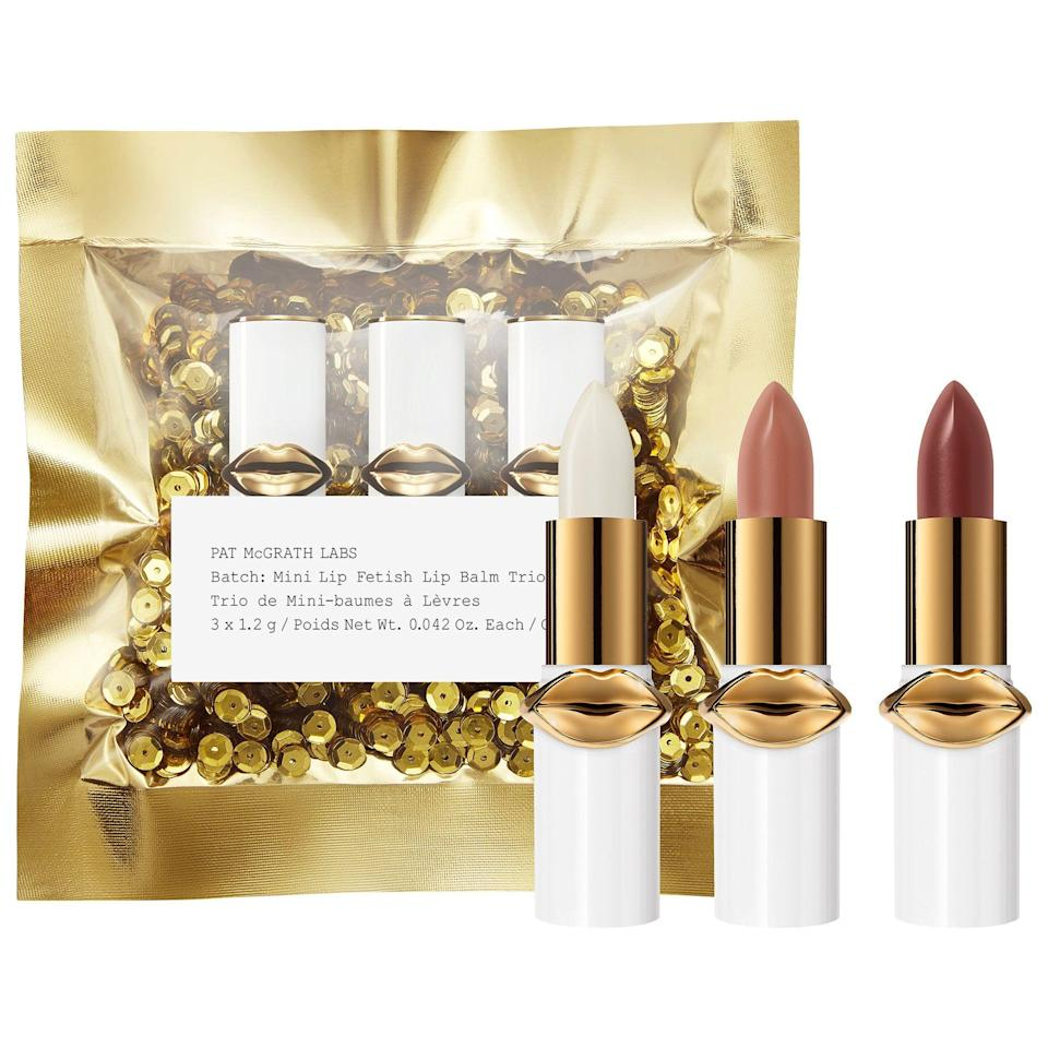 """<p><strong>PAT McGRATH LABS</strong></p><p>sephora.com</p><p><strong>$25.00</strong></p><p><a href=""""https://go.redirectingat.com?id=74968X1596630&url=https%3A%2F%2Fwww.sephora.com%2Fproduct%2Flust-mini-lip-fetish-lip-balm-trio-P446893&sref=https%3A%2F%2Fwww.prevention.com%2Flife%2Fg30609393%2Fvalentines-day-gifts-for-her%2F"""" rel=""""nofollow noopener"""" target=""""_blank"""" data-ylk=""""slk:Shop Now"""" class=""""link rapid-noclick-resp"""">Shop Now</a></p><p>Currently Sephora's bestselling gift under $25, this trio by famed makeup artist Pat McGrath boasts 26K """"loves"""" and is all about hydration with a pop of color. Mix and match from the three included shades and delight in the fact that the wrapping is done for you. (Recommended: a dollar-store bow.) </p>"""