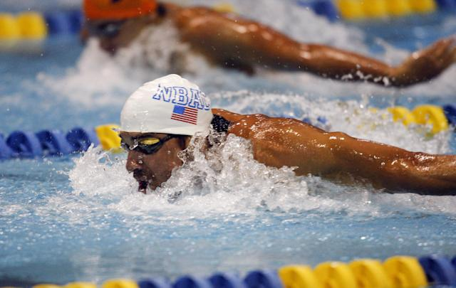 Michael Phelps wins the 100-meter butterfly in the at the Arena Grand Prix swim meet in Charlotte, N.C., Friday, May 16, 2014. (AP Photo/Nell Redmond)