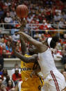 Central Michigan guard Micaela Kelly, left, goes up to shoot against Ohio State guard Sierra Calhoun during the first half of a second-round game in the NCAA women's college basketball tournament in Columbus, Ohio, Monday, March 19, 2018. (AP Photo/Paul Vernon)