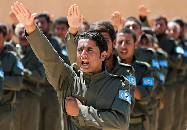 <p>Graduates of a U.S.-trained police force, which expects to be deployed in Raqqa, salute during a graduation ceremony near Ain Issa village, north of Raqqa, Syria, June 17, 2017. (Photo: Goran Tomasevic/Reuters) </p>