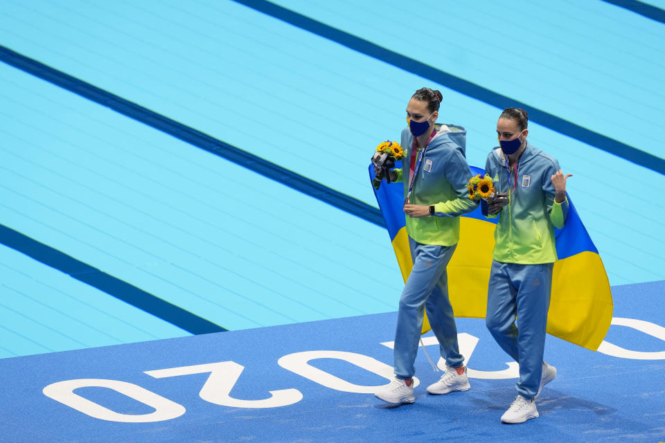 Marta Fiedina and Anastasiya Savchuk of Ukraine celebrate their silver medals in the Free Routine Final at the 2020 Summer Olympics, Wednesday, Aug. 4, 2021, in Tokyo, Japan. (AP Photo/Dmitri Lovetsky)