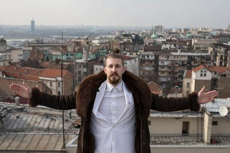 """Student and 2017 presidential candidate Luka Maksimovic, 25, poses for a picture as his alter ego 'Ljubisa """"Beli"""" Preletacevic' in Belgrade"""