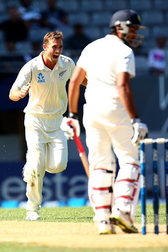 AUCKLAND, NEW ZEALAND - FEBRUARY 09:  Tim Southee of New Zealand celebrates his wicket of Rohit Sharma of India (R) during day four of the First Test match between New Zealand and India at Eden Park on February 9, 2014 in Auckland, New Zealand.  (Photo by Phil Walter/Getty Images)