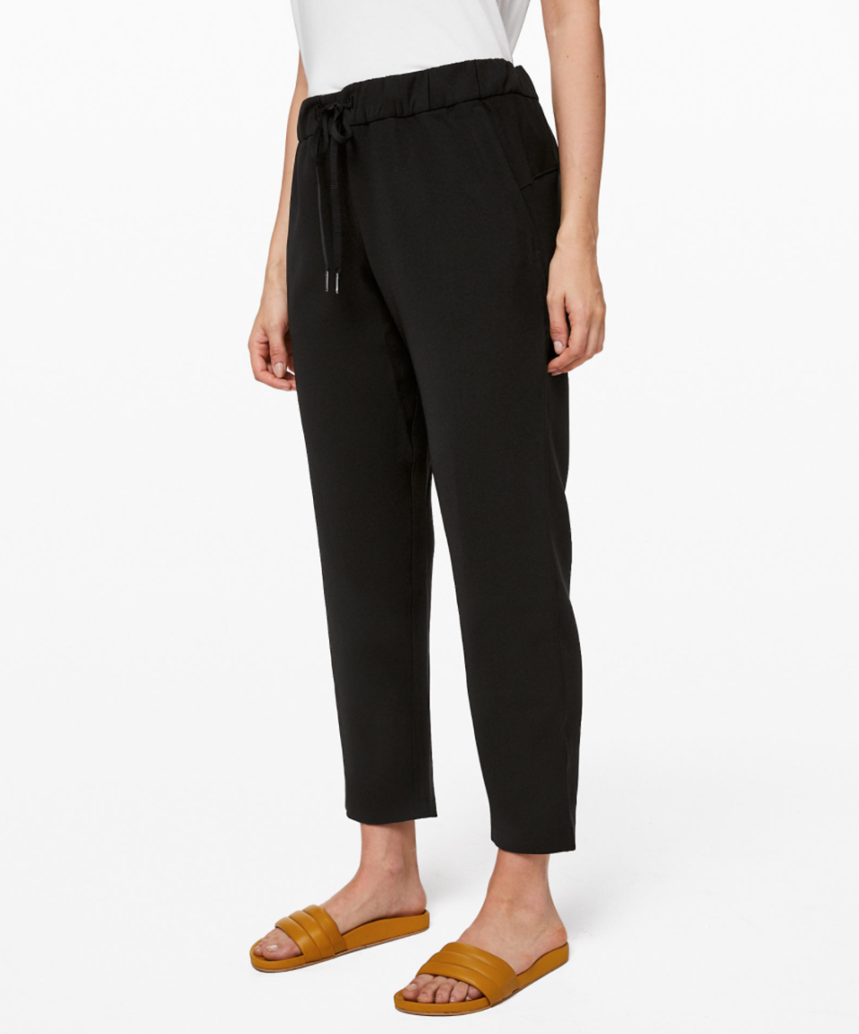 """<p><strong>Lululemon</strong></p><p>lululemon.com</p><p><a href=""""https://go.redirectingat.com?id=74968X1596630&url=https%3A%2F%2Fshop.lululemon.com%2Fp%2Fwomen-pants%2FOn-The-Fly-Pant-Woven-MD%2F_%2Fprod9070042&sref=https%3A%2F%2Fwww.marieclaire.com%2Ffashion%2Fg33262976%2Flululemon-warehouse-sale-july-2020%2F"""" rel=""""nofollow noopener"""" target=""""_blank"""" data-ylk=""""slk:SHOP IT"""" class=""""link rapid-noclick-resp"""">SHOP IT </a></p><p><del>$118</del><strong><br>$69—$79</strong></p><p>Looking for a pair of no-fuss pants that feel somewhat fancy? Lululemon has you covered. With a wrinkle-resistant fabric and drawstring waist, this option bridges the gap between style and comfort. </p>"""