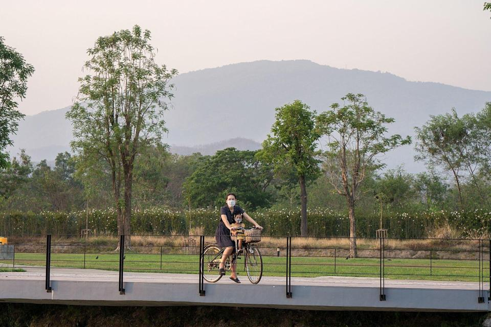 Mother And Daughter Riding Bicycle At Park in Chiang Mai, Thailand