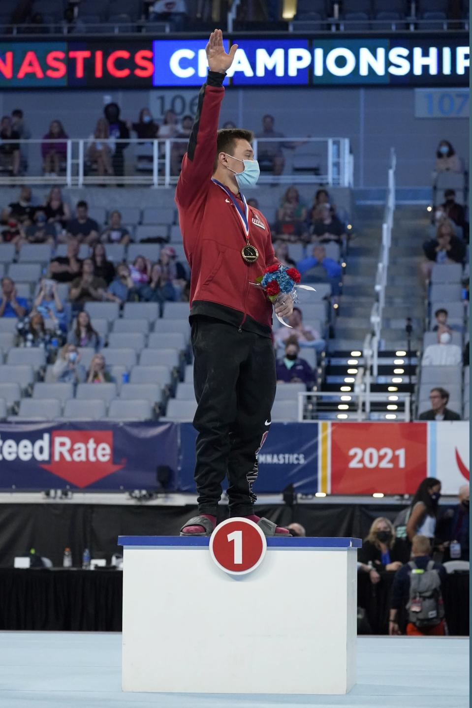 Brody Malone acknowledges cheers from fans after being awarded first place in the men's overall during the U.S. Gymnastics Championships, Saturday, June 5, 2021, in Fort Worth, Texas. (AP Photo/Tony Gutierrez)