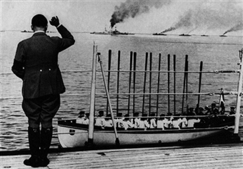 Fuhrer and Chancellor of Germany Adolf Hitler waving the ships on parade of the German Navy. Sailors in a lifeboat respond to the salute raising oars. Germany, June 1935 (Photo by Mondadori Portfolio via Getty Images)