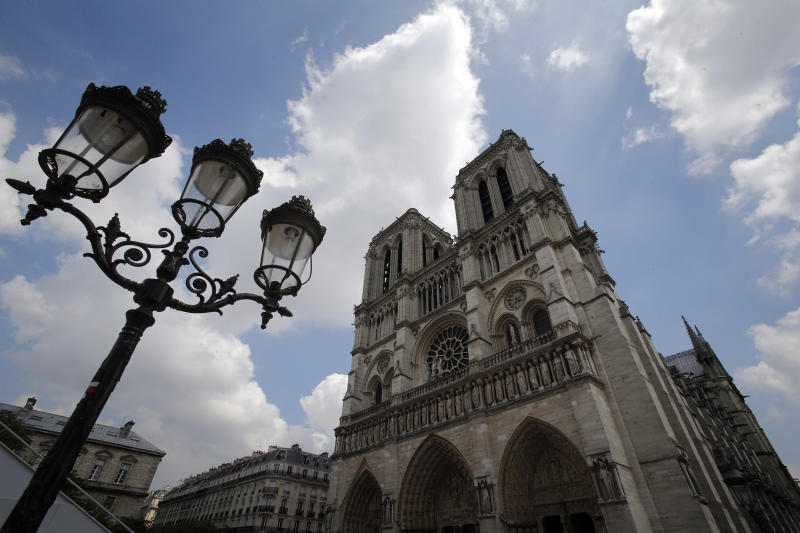 This Thursday May 2, 2013 photo shows Notre Dame cathedral in Paris. The famous cathedral's pipe organ was refurbished for the 850th anniversary this year. (AP Photo/Christophe Ena)