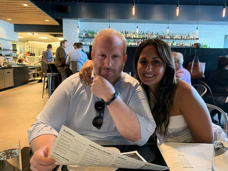 This handout picture courtesy of Rachelle Eid shows Samy Eid, owner of three top restaurants in Michighan, and his fiance Francesca George on August 6, 2019 in a restaurant in Detroit. (AFP Photo/FAMILY HANDOUT)