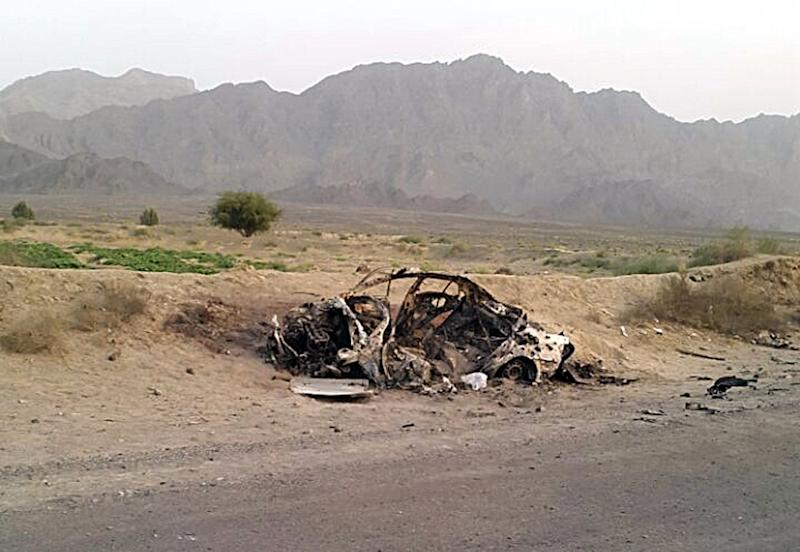 The destroyed vehicle in which Taliban leader Mohammad Akhtar Mansour was traveling in the Baluchistan province of Pakistan, near the Afghanistan border