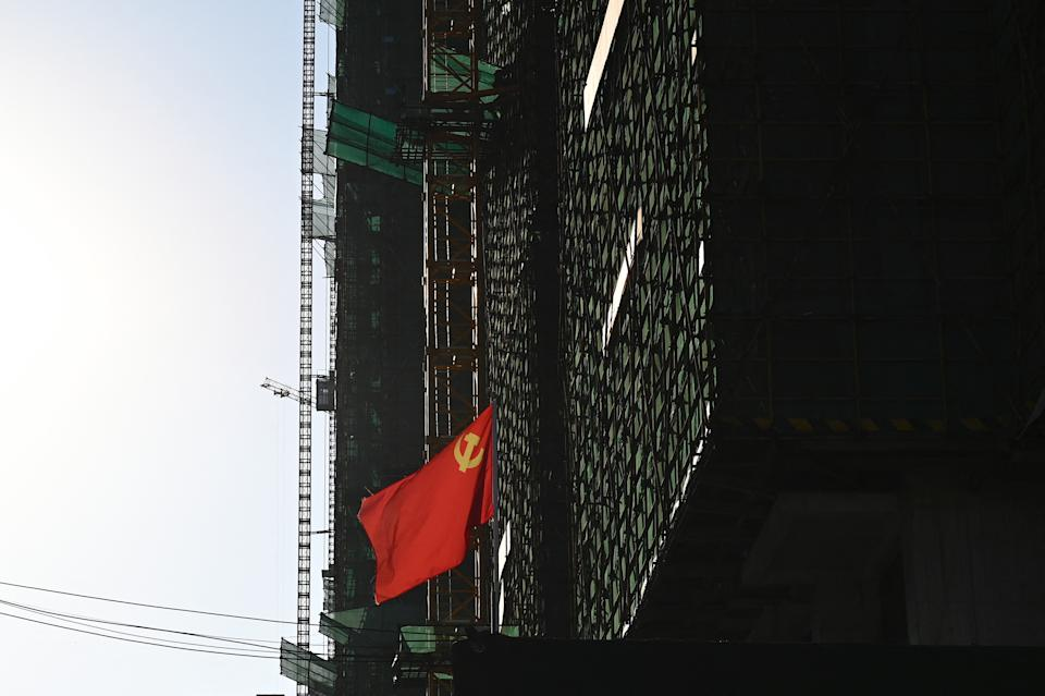 A communist party flag is seen at the construction site of an Evergrande housing complex in Zhumadian, central Chinas Henan province on September 14, 2021. (Photo by JADE GAO / AFP) (Photo by JADE GAO/AFP via Getty Images)