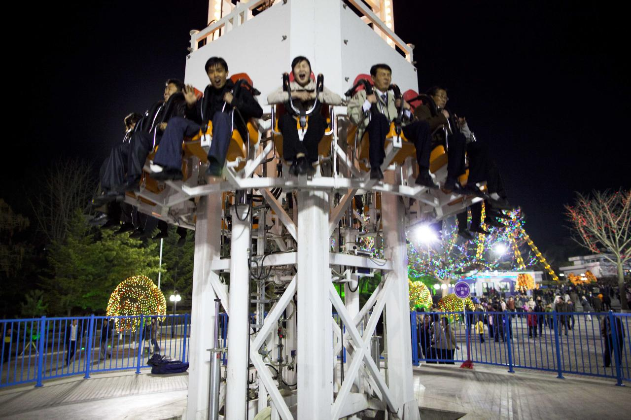 In this April 16, 2011 photo, people react on a ride at an amusement park in Pyongyang, North Korea. (AP Photo/David Guttenfelder)