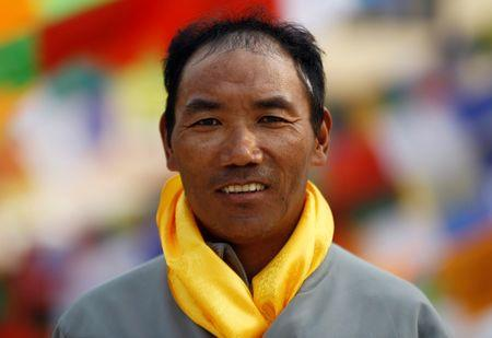 Kami Rita Sherpa, 48, who is attempting a world record by climbing Mount Everest for the 22nd time this season, poses for a picture at Boudhanath Stupa in Kathmandu, Nepal March 26, 2018. REUTERS/Navesh Chitrakar