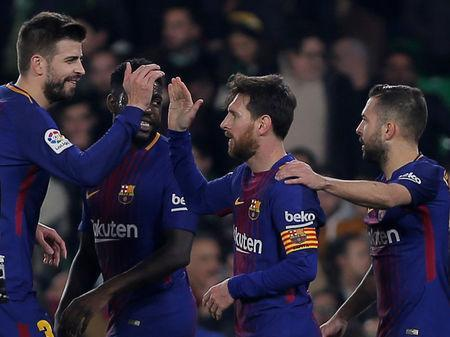 Soccer Football - La Liga Santander - Real Betis vs FC Barcelona - Estadio Benito Villamarin, Seville, Spain - January 21, 2018 Barcelona's Lionel Messi celebrates scoring their fourth goal with team mates REUTERS/Jon Nazca