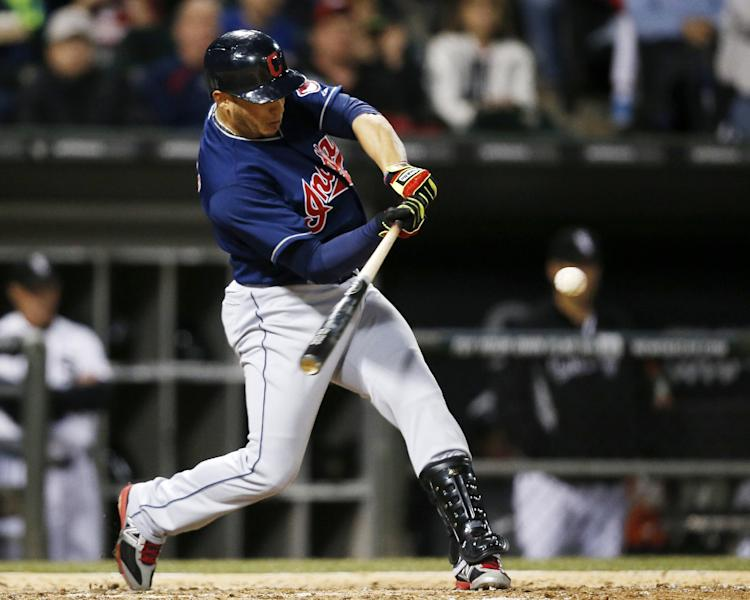 Cleveland Indians' Asdrubal Cabrera hits a two-RBI double against the Chicago White Sox during the fifth inning of a baseball game on Friday, April 11, 2014, in Chicago. (AP Photo/Andrew A. Nelles)