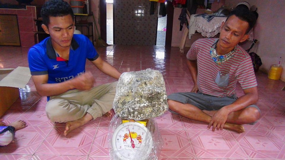 Asaree Pooad, 24, and his dad with one of the ambergris lumps. Source: Newsflash/Australscope