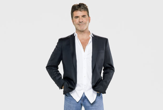 Simon Cowell breaks back after bike accident