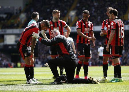 Britain Soccer Football - Tottenham Hotspur v AFC Bournemouth - Premier League - White Hart Lane - 15/4/17 Bournemouth's Jack Wilshere receives medical attention after sustaining an injury Action Images via Reuters / Paul Childs Livepic