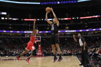 Los Angeles Clippers guard Landry Shamet, right, shoots over Chicago Bulls forward Kris Dunn during the first half of an NBA basketball game Saturday, Dec. 14, 2019, in Chicago. (AP Photo/Nam Y. Huh)