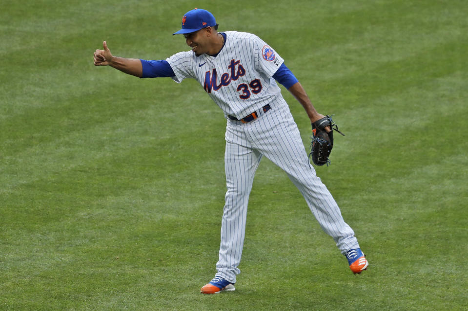 New York Mets relief pitcher Edwin Diaz reacts after the last out of a baseball game against the Atlanta Braves at Citi Field, Friday, July 24, 2020, in New York. (AP Photo/Seth Wenig)