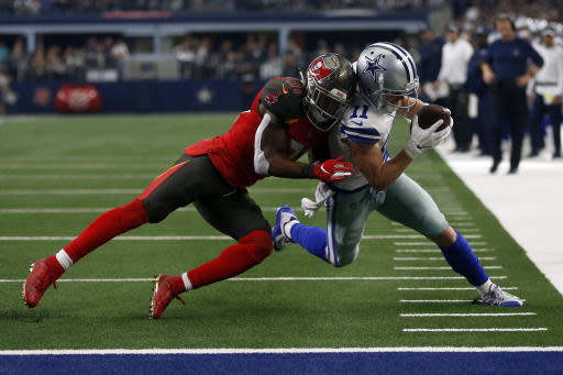 Tampa Bay Buccaneers safety Jordan Whitehead (31) stops Dallas Cowboys wide receiver Cole Beasley (11) from reaching the end zone after catching a pass in the second half of an NFL football game in Arlington, Texas, Sunday, Dec. 23, 2018. (AP Photo/Ron Jenkins)