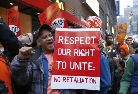 Fast food workers attend a protest against McDonald's outside one of its restaurants in New York, in this file photo taken December 5, 2013REUTERS/Eduardo Munoz/Files