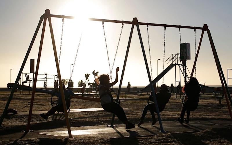 Children play on the public play gyms - EPA