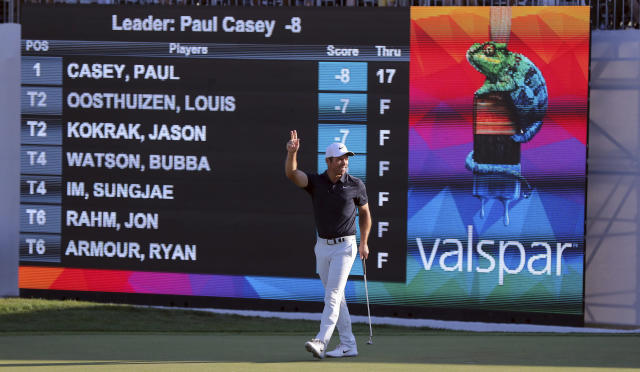 Paul Casey celebrates after the final putt on the 18th hole to win the Valspar Championship golf tournament Sunday, March 24, 2019, in Palm Harbor, Fla. (AP Photo/Mike Carlson)