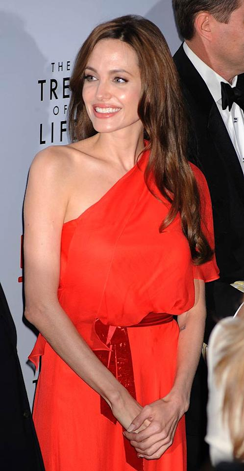 """<i>OK!</i> reports that Angelina Jolie has gone """"nuclear"""" over Brad Pitt's """"flirtatious relationship"""" with a production staffer on the set of """"World War Z"""" – and she """"can't take it anymore!"""" The mag says a """"jealous"""" Jolie is furious that the brunette employee is """"rocking"""" her relationship with Pitt, who seems to be """"happier"""" when the staffer is around. For how Pitt shockingly feels about his """"mystery woman,"""" and what Jolie plans to do next, click over to <a href=""""http://www.gossipcop.com/brad-pitt-mystery-woman-name-world-war-z-flirting-angelina-jolie/"""" target=""""new"""">Gossip Cop</a>. Jeffrey Mayer/<a href=""""http://www.wireimage.com"""" target=""""new"""">WireImage.com</a> - May 24, 2011"""