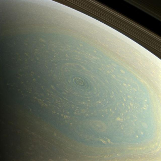 The north pole of Saturn, in the fresh light of spring, is revealed in this color image from NASA's Cassini spacecraft. The north pole was previously hidden from the gaze of Cassini's imaging cameras because it was winter in the northern hemisphere when the spacecraft arrived at the Saturn system in 2004. (Courtesy: NASA/JPL-Caltech/SSI)