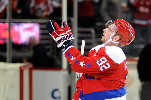 WASHINGTON, DC - FEBRUARY 24: Evgeny Kuznetsov #92 of the Washington Capitals tosses a puck to the fans after the game against the Edmonton Oilers at Verizon Center on February 24, 2017 in Washington, DC. (Photo by Greg Fiume/NHLI via Getty Images)