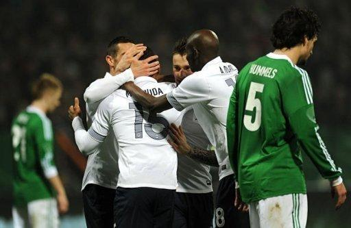 French midfielder Florent Malouda (C) celebrates scoring with his teammates during the International friendly football match Germany vs France in the northern German city of Bremen in preperation for the UEFA Euro 2012