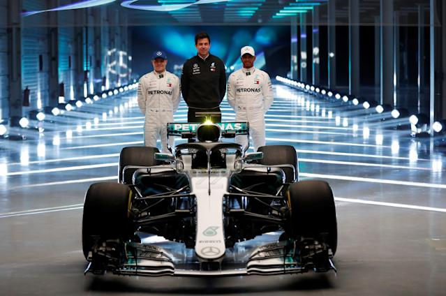 F1 Formula One - Mercedes 2018 Car Launch - Silverstone Circuit, Towcester, Britain - February 22, 2018 Mercedes' Lewis Hamilton, Valtteri Bottas and Executive Director Toto Wolff pose with the new car during the launch Action Images via Reuters/Matthew Childs