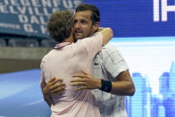 Mate Pavic, of Croatia, right, and Bruno Soares, of Brazil, celebrate winning the men's doubles final against Wesley Koolhof, of the Netherlands, and Nikola Mektic, of Croatia, during the US Open tennis championships, Thursday, Sept. 10, 2020, in New York. (AP Photo/Seth Wenig)