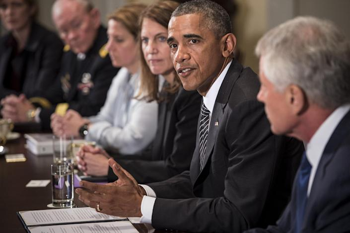 US President Barack Obama makes a statement for the press after a meeting in the Cabinet Room of the White House on October 15, 2014 in Washington, DC (AFP Photo/Brendan Smialowski)
