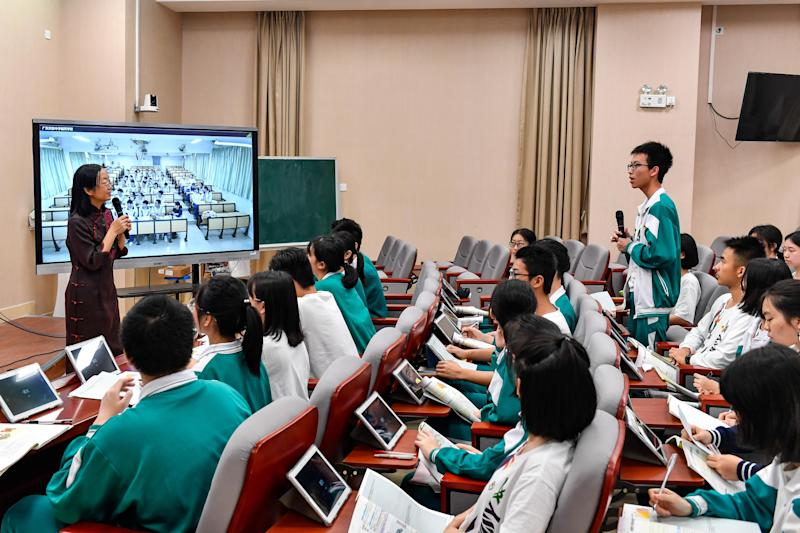 GUANGZHOU, CHINA - MARCH 29: Students from the main campus and branch campus of Guangdong Experimental High School take the same class through live broadcast via the 5G network supported by China Telecom on March 29, 2019 in Guangzhou, Guangdong Province of China. (Photo by Chen Jimin/China News Service/Visual China Group via Getty Images)