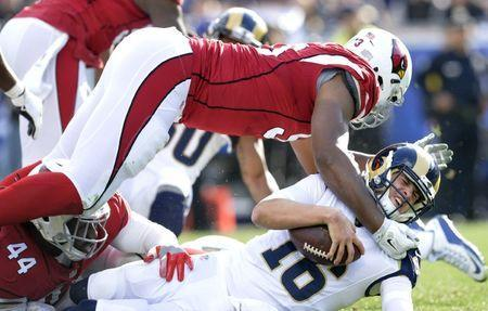 January 1, 2017; Los Angeles, CA, USA; Los Angeles Rams quarterback Jared Goff (16) is brought down by Arizona Cardinals defensive end Calais Campbell (93) during the first half at Los Angeles Memorial Coliseum. Gary A. Vasquez-USA TODAY Sports