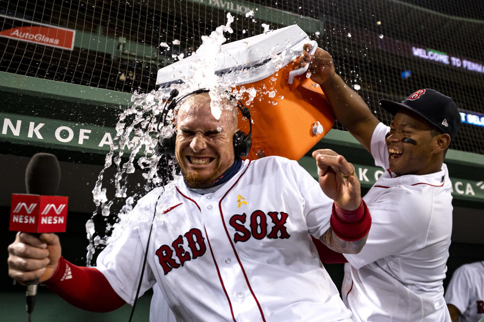 BOSTON, MA - SEPTEMBER 5: Christian Vazquez #7 of the Boston Red Sox is doused with Gatorade after scoring the game winning run on a walk-off infield single by Yairo Munoz #60 of the Boston Red Sox during the ninth inning of a game against the Toronto Blue Jays on September 5, 2020 at Fenway Park in Boston, Massachusetts. The 2020 season had been postponed since March due to the COVID-19 pandemic. (Photo by Billie Weiss/Boston Red Sox/Getty Images)
