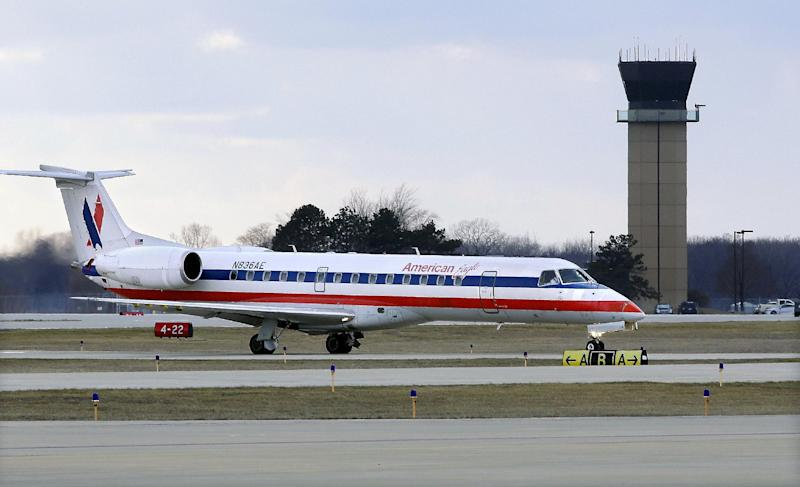 In this March 12, 2013 photo, an American Eagle jet taxis to a gate past the control tower after landing at the Abraham Lincoln Capital Airport in Springfield, Ill. The airport is one of nearly 240 small airports around the country that will likely shut down their air traffic control towers under federal budget cuts, stripping away a layer of safety during takeoffs and landings and leaving many pilots to manage the most critical stages of flight on their own. (AP Photo/Seth Perlman)