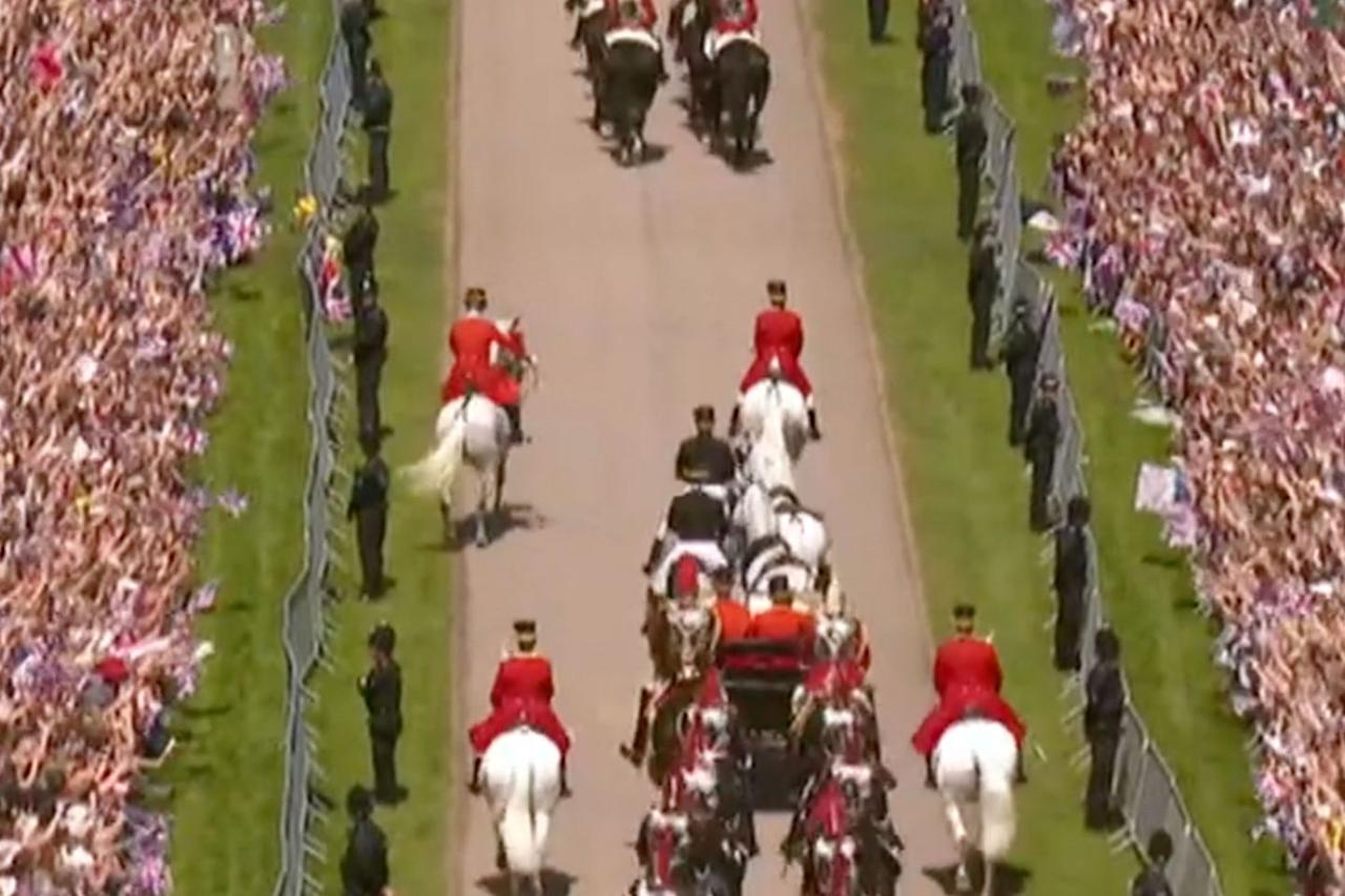 <p>Having animals in your wedding pr0cession could go either way. For the most part, the white stallions accompanying Prince Harry and Megan stayed the course but one horse seemed to have his own agenda. Members of the Queen's Guard cavalry are well-trained and the rider quickly got the horse back in line.</p>