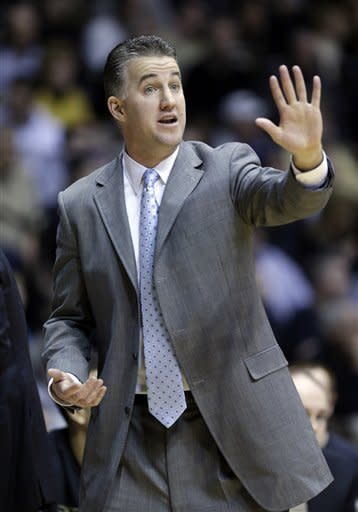 Purdue head coach Matt Painter tells his team to slow down as they played West Virginia in the first half of an NCAA college basketball game in West Lafayette, Ind., Saturday, Jan. 19, 2013. Purdue defeated West Virginia 79-52. (AP Photo/Michael Conroy)
