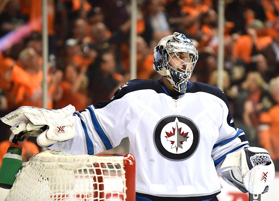 ANAHEIM, CA - APRIL 16:  Ondrej Pavelec #31 of the Winnipeg Jets reacts after the announcement of a Corey Perry #10 of the Anaheim Ducks, using video replay, resulting in a 3-2 Ducks lead during the third period in Game One of the Western Conference Quarterfinals during the 2015 NHL Stanley Cup Playoffs at Honda Center on April 16, 2015 in Anaheim, California.  (Photo by Harry How/Getty Images)