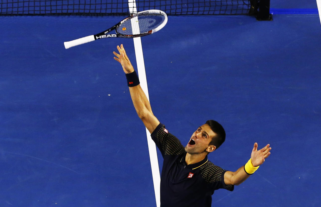 Novak Djokovic of Serbia celebrates defeating Andy Murray of Britain in their men's singles final match at the Australian Open tennis tournament in Melbourne January 27, 2013. Djokovic became the first man to win three successive Australian Open titles in the professional era.  REUTERS/David Gray (AUSTRALIA  - Tags: SPORT TENNIS TPX IMAGES OF THE DAY)   - RTR3D16H