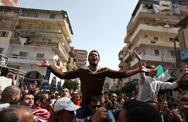 Egyptian protesters chant angry slogans during a demonstration after the noon prayer in Port Said, Egypt, Friday, March 8, 2013. With the country in chaos from weeks of protests against the Islamist president, the police have now joined the fray, launching their own protests. Some security forces in Port Said have refused to leave their barracks to move against protesters in the street amid clashes raging for days. Others have refused orders to deploy to Port Said from elsewhere to help in the fight. (AP Photo/Khalil Hamra)