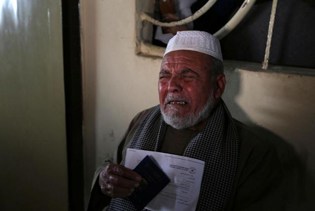<p>A Palestinian man cries as he asks for a permit to cross into Egypt through the Rafah border crossing after it was opened by Egyptian authorities for humanitarian cases, in the southern Gaza Strip, Feb. 7, 2018. (Photo: Ibraheem Abu Mustafa/Reuters) </p>
