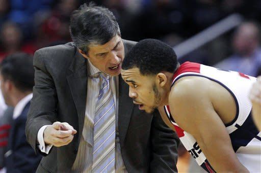 Washington Wizards head coach Randy Wittman talks with Wizards center JaVale McGee in the second quarter of an NBA basketball game against the Miami Heat in Washington, on Friday, Feb. 10, 2012. (AP Photo/Jacquelyn Martin)