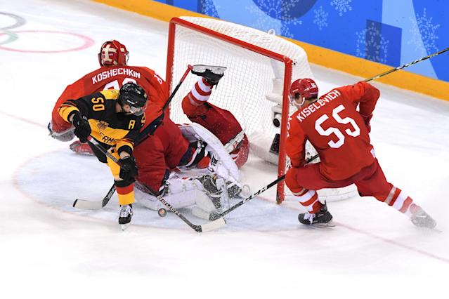 <p>Patrick Hager #50 of Germany attempts a shot against Vasili Koshechkin #83 and Bogdan Kiselevich #55 of Olympic Athlete from Russia in the third period during the Men's Gold Medal Game on day sixteen of the PyeongChang 2018 Winter Olympic Games at Gangneung Hockey Centre on February 25, 2018 in Gangneung, South Korea. (Photo by Harry How/Getty Images) </p>