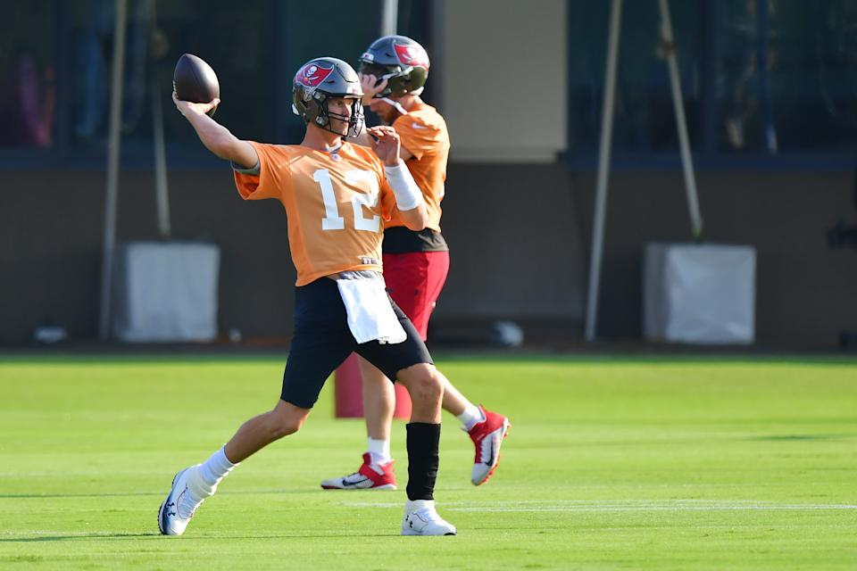 TAMPA, FLORIDA - JULY 25: Tom Brady #12 of the Tampa Bay Buccaneers throws a pass during training camp at AdventHealth Training Center on July 25, 2021 in Tampa, Florida. (Photo by Julio Aguilar/Getty Images)